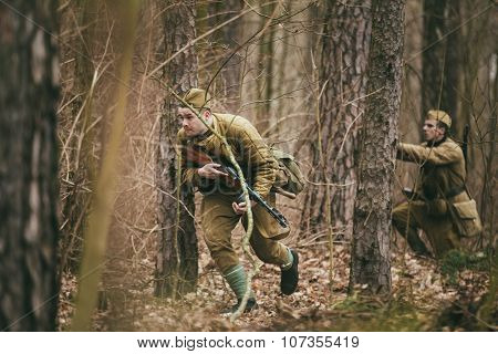 Unidentified re-enactor dressed as Soviet russian soldier runnin