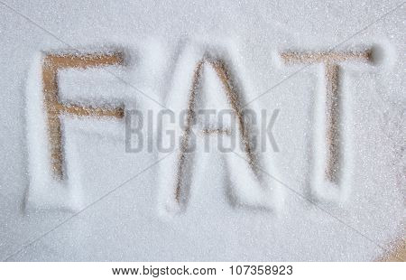 The Word Fat Written Into A Pile Of White Granulated Sugar Background