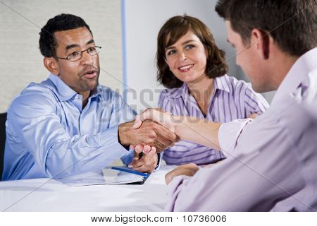 Three Business People Meeting, Men Shaking Hands