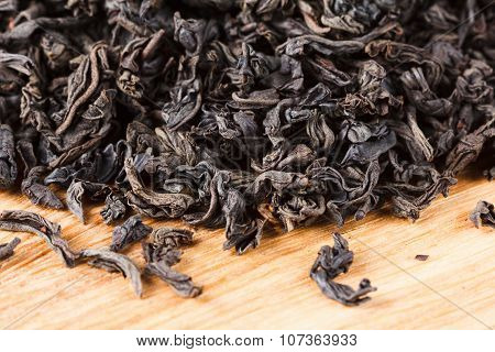 Black Tea Dry Leaves. Macro, Background