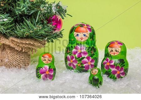 Russian Wooden Dolls With Snow And Christmas Tree