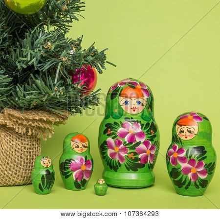 Russian Wooden Dolls Around A Christmas Tree