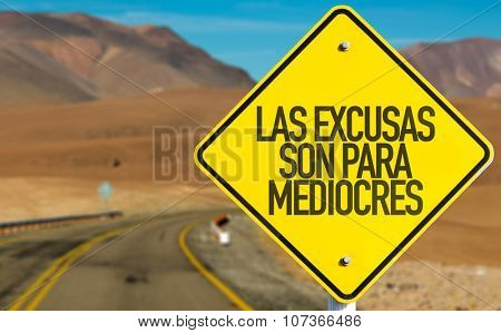 Excuses are for Average People (in Spanish) sign on desert road