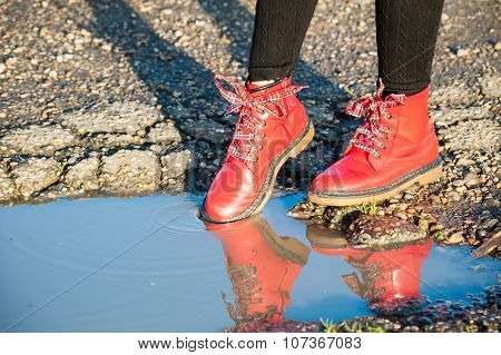 Red shoes in puddle
