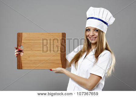 Portrait Of Beauty Woman Chef Hold A Plate And Presenting