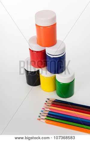 Set Of Colored Pencils And Paints For Children's Creativity