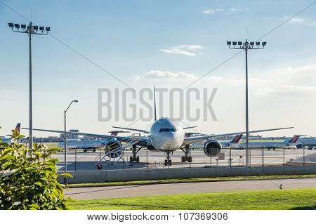 Airliner Parked At Fence