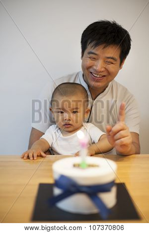 father and son celebrating son's birthday