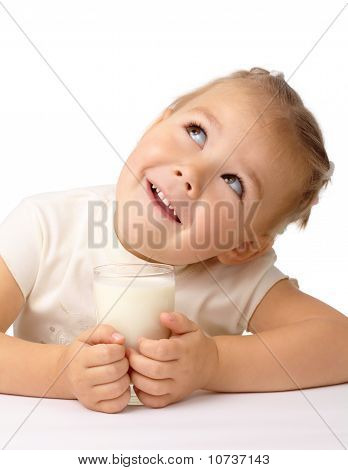 Little Girl With A Glass Of Milk Looks Up