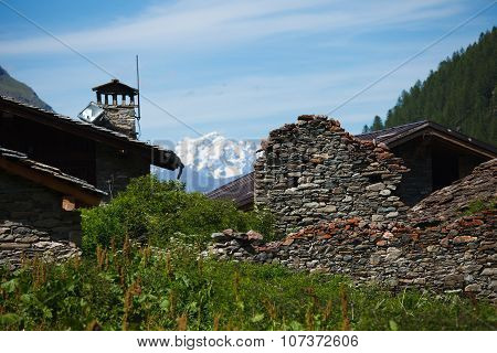 Mountain village and Mont Blanc, Aosta, Alps, Italy