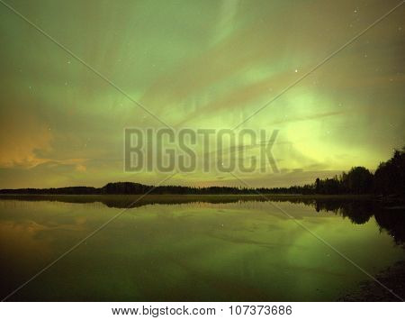 Northern Lights At Night Over Lake