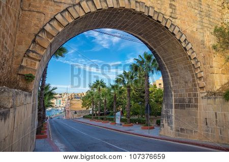Arch of Valletta with palm trees and blue sky - Malta