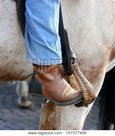 Cowboy Foot In The Stirrup Of The Horse