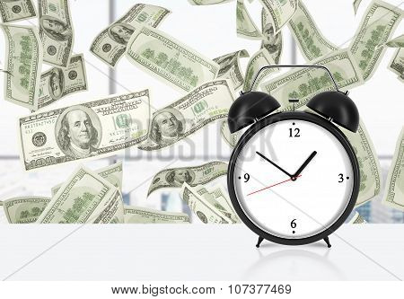 An Alarm Clock Is On The Table. Falling Dollar Notes On Background. The Concept Of 'time Is Money' A