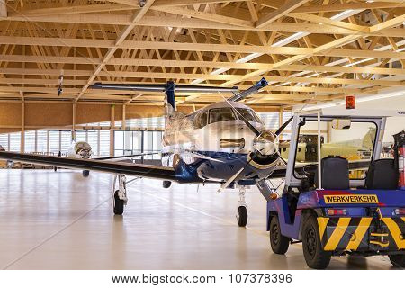 Stans, Switzerland - 29Th November 2010: Single Turboprop Aircraft Pilatus Pc-12 In Hangar.