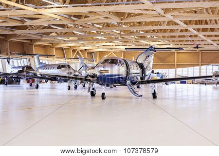 Stans, Switzerland, 29Th November 2010: Single Turboprop Aircraft Pilatus Pc-12 In Hangar.