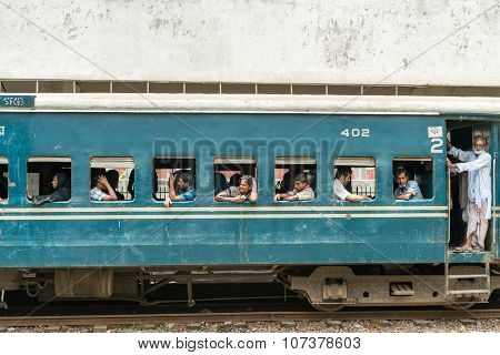 Commuters In Train Looking Through Window