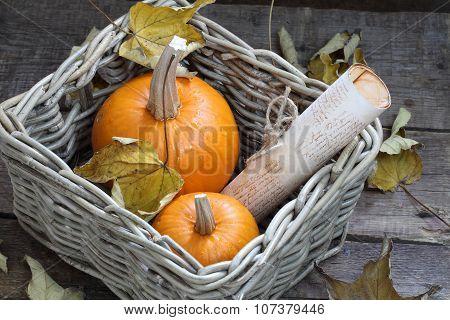 Orange Pumpkins In A Wattled Basket