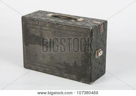 Old Suitcase With Gramophone Standing On A White Background Isolated