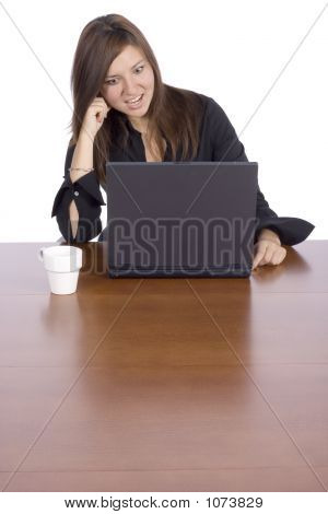 Surprise Woman At The Table With Notebook