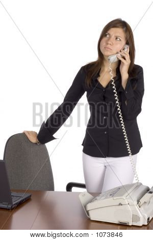 Irritated Standing Businesswoman On The Phone