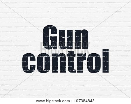 Security concept: Gun Control on wall background