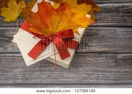 Closeup Of Decorative Gift Box Over Wooden Background