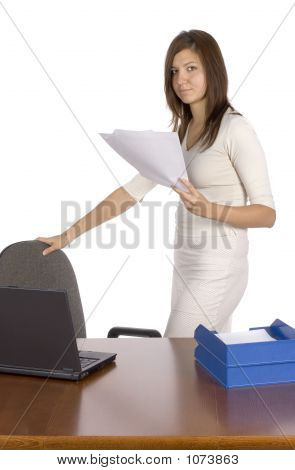 Standing Businesswoman Keeps Papers