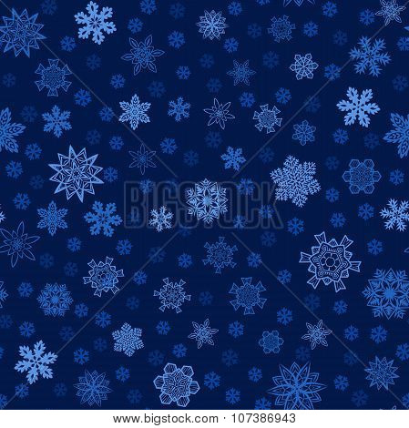 Seamless blue winter background with snowflakes