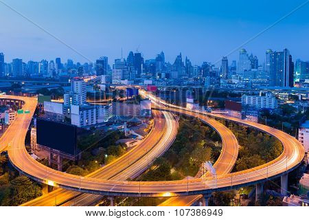 Twilight of city downtown highway curved