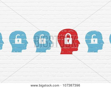 Business concept: head with padlock icon on wall background