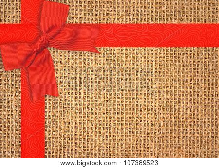 Burlap Texture Background With Red Ribbon And Bow
