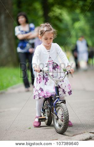 Cute Little Girl On Bike