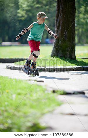 Little Boy On Rollerblades
