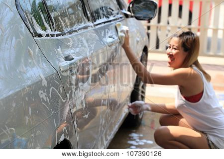 Happy Woman Washing Car
