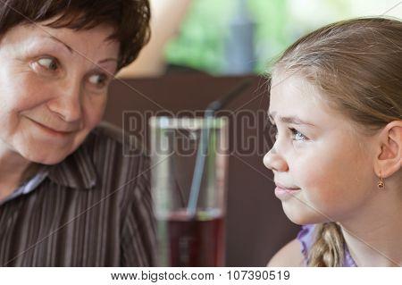 Grandma Smiling To Her Granddaughter