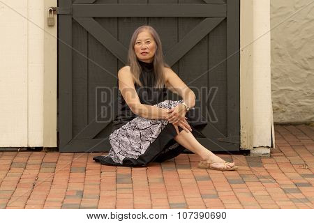 Woman Rests By Locked Door
