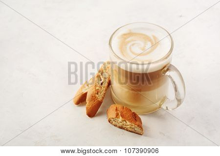 Cappuccino With Biscotti Or Cantucci On A White Table