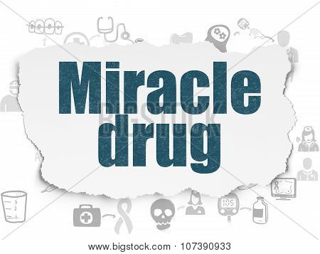 Health concept: Miracle Drug on Torn Paper background