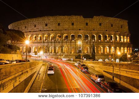 Rome, Italy - September 11, 2015: Colosseum at night with colorful blurred traffic lights. Rome - Italy on September 11, 2015.