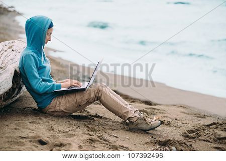 Freelancer Working On Notebook On Coast
