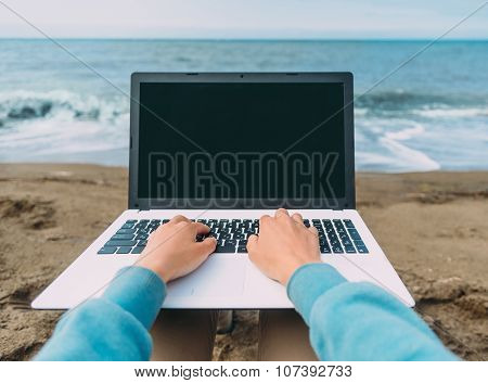 Pov Image Of Working On Laptop On Beach