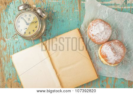 Sweet Sugary Donuts, Book And Vintage Clock On Rustic Table