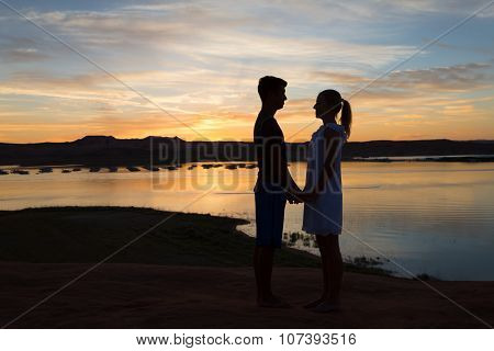 Loving Boy And Girl At Sunset