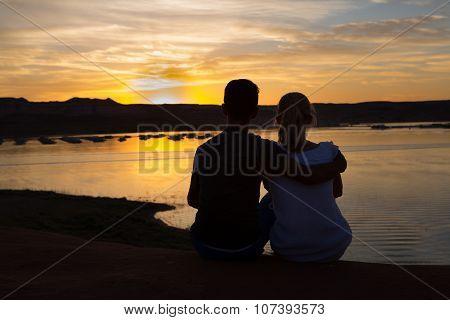 Couple Sitting At Sunset