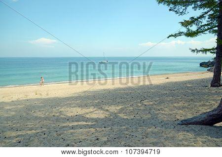 Baikal, Russia - July, 28 2015:The picturesque sandy beach.  The western coast of Lake Baikal