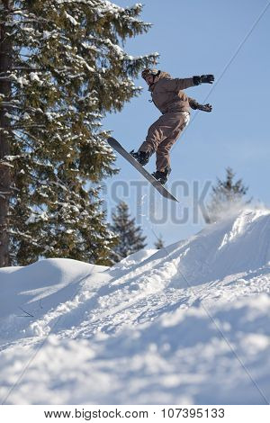 Jump Of Man Snowboarder