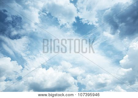 blue sky background as frame with cumulus clouds