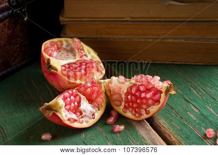 Broken Pomegranate On Green Board
