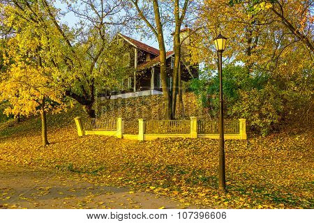 Country Home On Hillock In Autumn